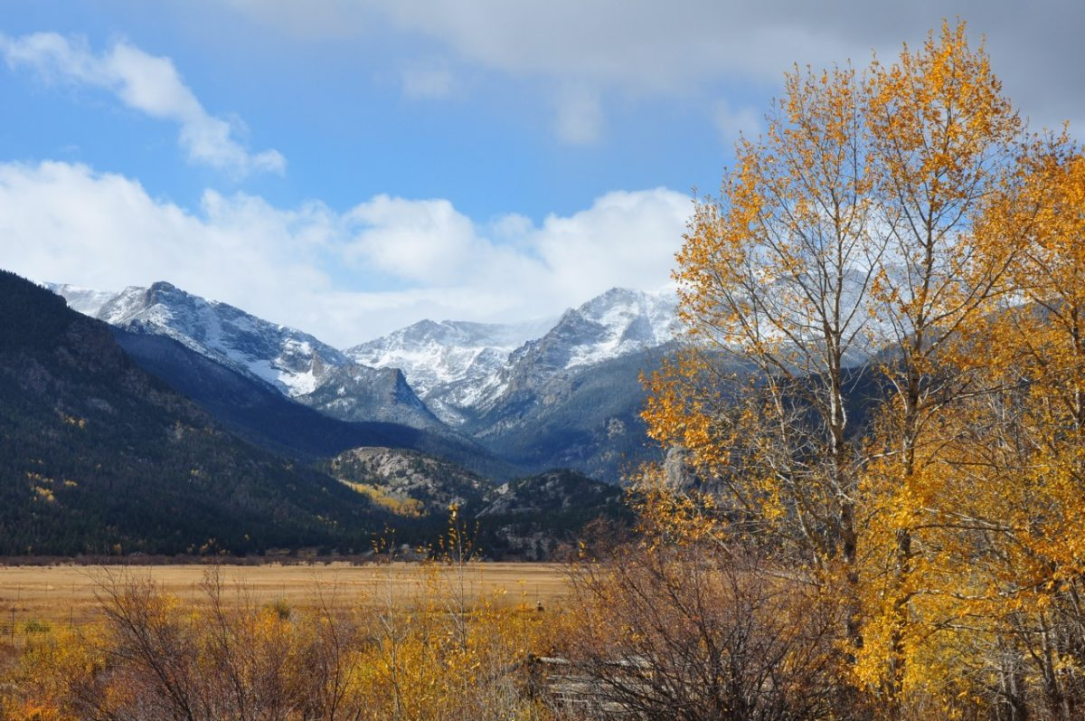 Broad valley in front of mountains in Rocky Mountain National Park during fall.